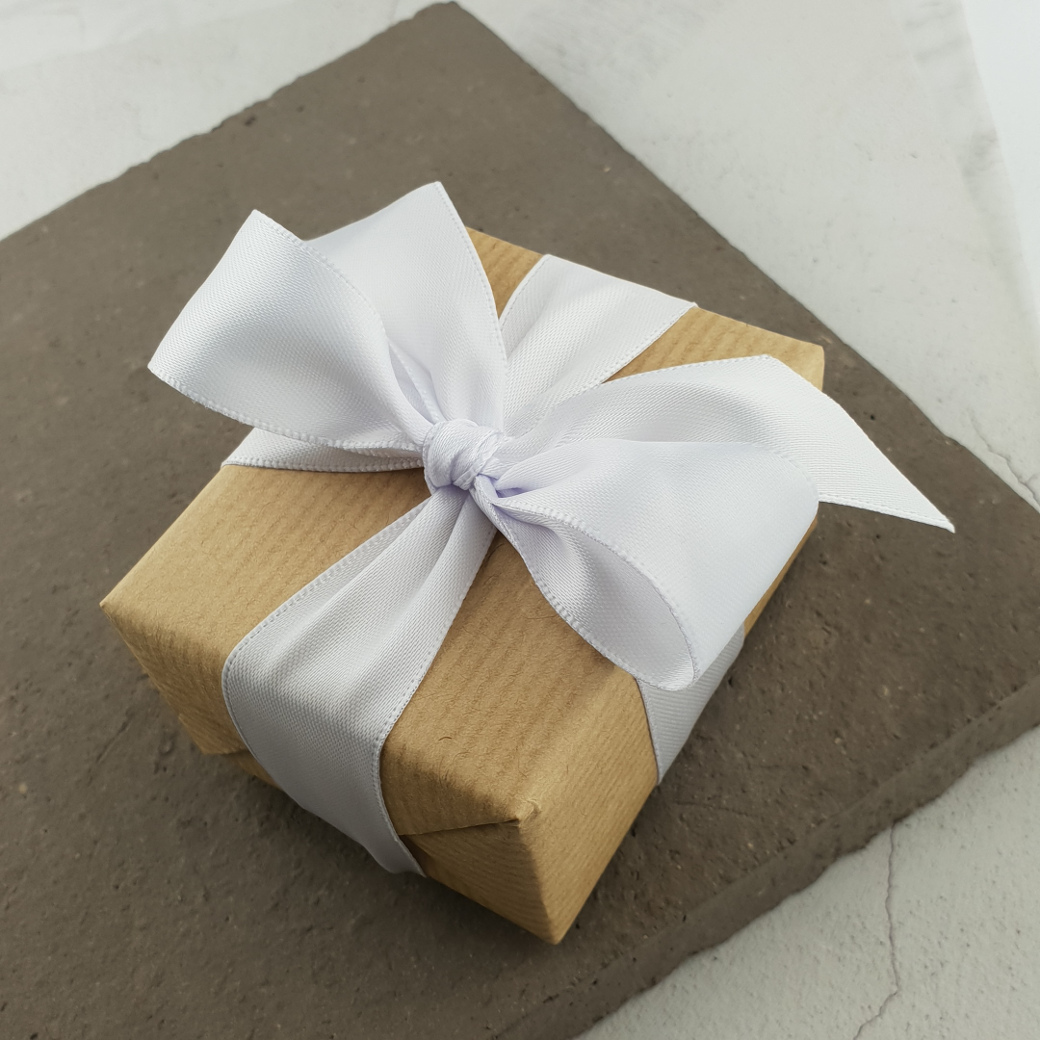 white ribbon gift wrapping